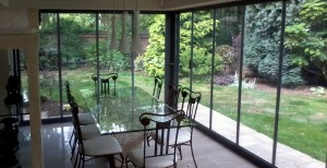Double glazed, fully retractable, framless glass doors