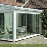 conservatory with double glazed frameless glass doors