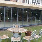 double glazed retractable multi-door sets on 3 sides of new extension