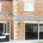 aluminium+glass fixed awning + bifolding doors