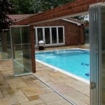 single glazed frameless glass retractable doors pool enclosure