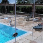 single glazed tempered glass doors forming retractable swimming pool enclosure