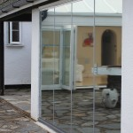 single glazed frameless doors with reflective privacy coating for one-way glass