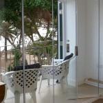 Internal retractable frameless glass partition doors