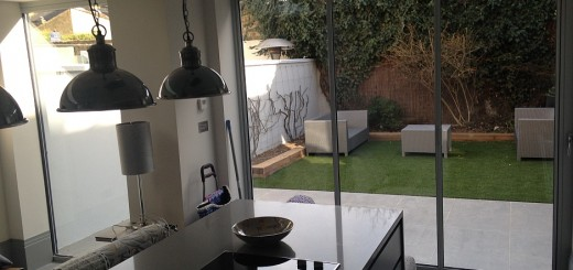 view through ultraslim doors from contemporary kitchen