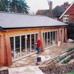 Classic bi folding doors on pool housing