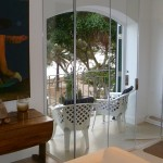 single glazed retractable frameless glass doors forming an interior porch