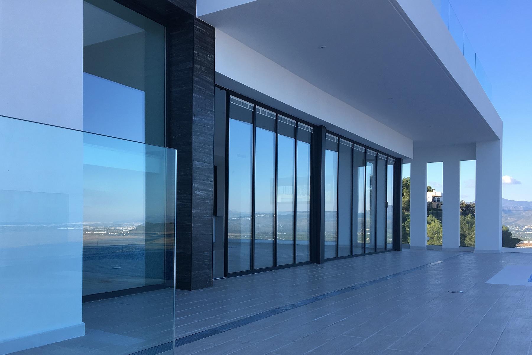 SunSeeker UltraSlim Glass Doors & Enjoying a Movable Wall of Glass! - Sunseeker Doors