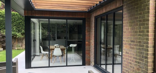 extension with UltraSlim slide-pivot-stack doors