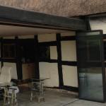 Thatched Hosue with sympathetic enclosure, UltraSlim slide-turn-stack doors